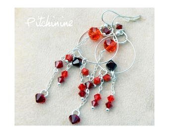 Large and very light these fake hoop earrings are shades of Red Swarovski crystals with sterling silver findings