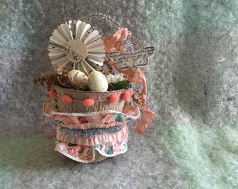 Altered peat pot Easter decoration