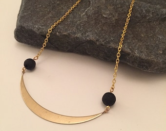 Lava rock & crescent moon brass curve necklace