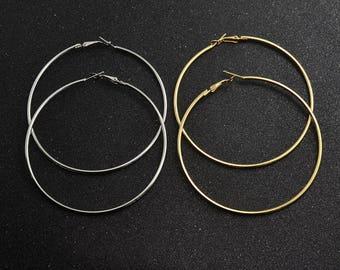silver or gold 7.5cm hoop earrings.