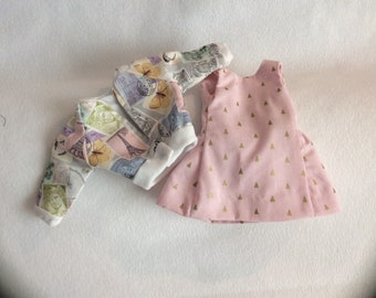 This sleeveless pink summer dress and travel theme jacket is perfect for travel and parties for Wellie Wisher dolls.