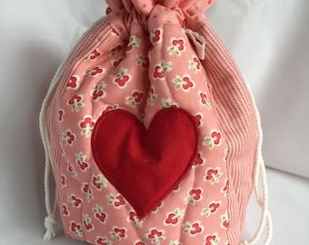 Salmon pink patchwork drawstring bag
