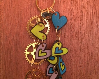 Hearts and gears shrink art charm necklace in gold