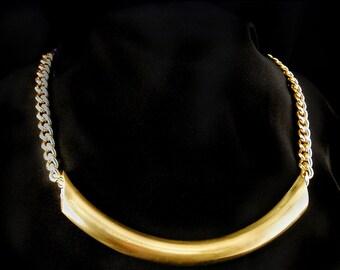 Bold glowing brass tube on chunky brass chain
