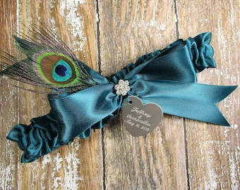 Teal Wedding Garter with a Peacock Feather and Personalized Engraving
