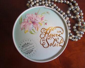 Vintage Les Fleurs du Soleil Baylis & Harding dusting powder with powder puff. Complete unused.