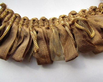 Amazing ribbon Fringe trim in bronge gold