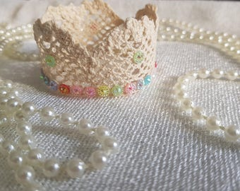 Newborn jewel posing crown