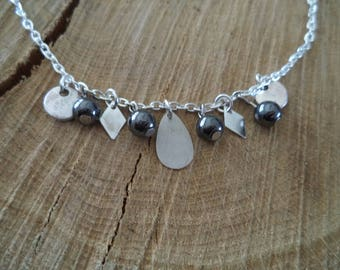 Fine silver with grey metal beads and silver charms bracelet