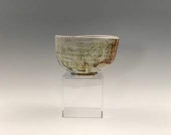 Wood fired porcelain matcha chawan, Japanese teabowl, anagama woodfired with shino and natural ash glazes. Pottery, ceramic, tea ceremony.