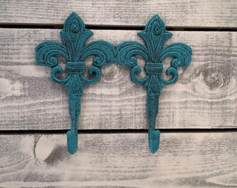 Fleur De Lis Cast Iron Double Wall Hooks, Hand Painted Distressed Process Seaside Blue Over Black, Ornate Towel Hook, Item #504878080