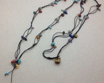 Long multicolor necklace with natural stone chips. 3 threads. Craft.