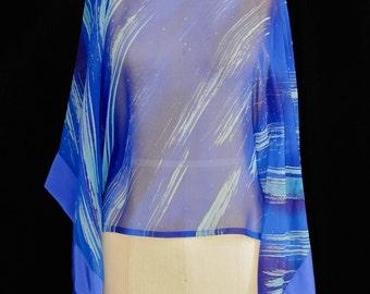 Jet Stream blue silk chiffon poncho top with diagonal aqua streaks.