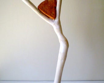 Character drift wood carved head in river stone