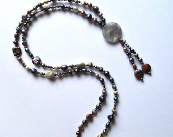 Long sautoir necklace of freshwater pearls with faceted quartz pendant