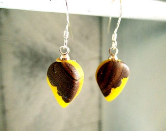 These bright yellow earrings look like a candy. Handmade.