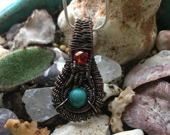 Copper, howlite, and red bead pendant