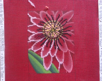 needlepoint canvas, flower on pink partially worked, 8 by 11 inches .
