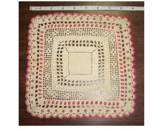 "Red and white crocheted doily. Measures 9"" by 9"". Very fine cotton yarn was used to filet crochet this piece."