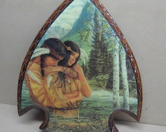 Indian couple in the woods on large arrowhead clock