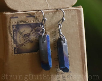 Strung-Out guitar string earrings with electric blue crystal points