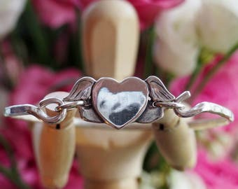 Gorgeous hand made fine silver flying heart and wings on a sterling silver bangle...