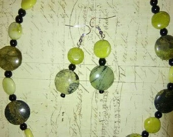 This is a hand made necklace and earring set made by me. It's yellow turquoise black glass and Jade button beads.