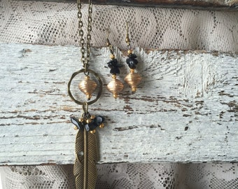 Champagne gold necklace with feather