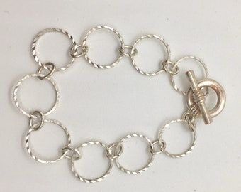 bracelet; sterling silver circles toggle