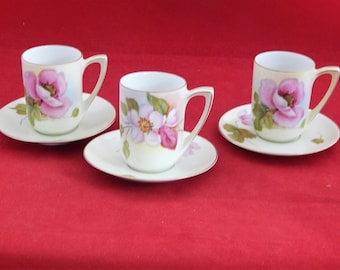 Three RS.TILLOWITZ chocolate cups and saucers.painted Roses & Apple Blossoms.
