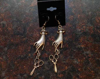 silver hands with scissors earrings.