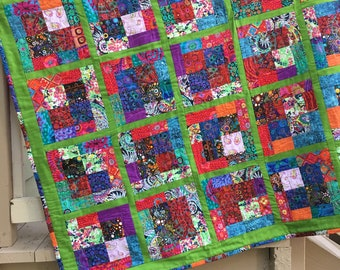 kaffe Fassett and other fabrics create squares of color in lattice of green - 54 x 54.