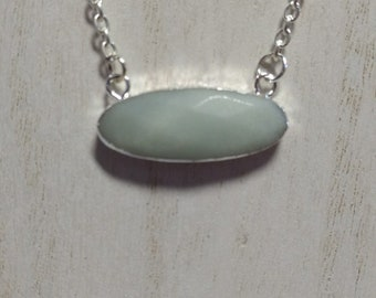 White opaque chalcedony pendant on silver plated chain