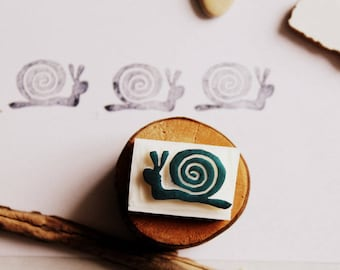 Carved stamp snail handmade