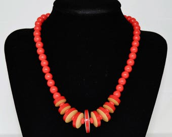 Vintage Necklace with Red Beads and Plastic Discs Resembling Wood