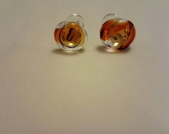 Glass cufflinks in clear and amber glass