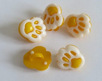 White and dark yellow animal print button