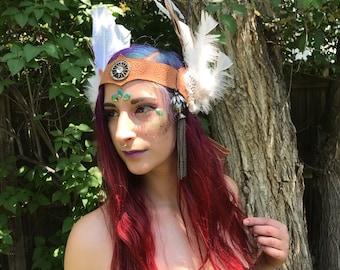 Imprinted, embellished leather, feathered headdress