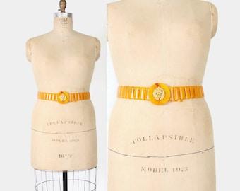 Vintage 60s Butterscotch Plastic Flex BELT / 1960s Fakelite Gold LION Belt