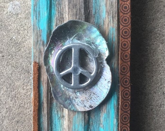 Wall hanging with peace symbol