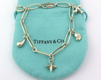Authentic TIFFANY & CO Sterling Silver Elsa Peretti Five Charm Bracelet