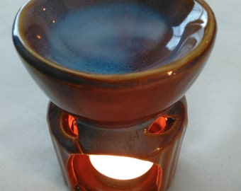 Elegance Fragrance Warmers with three small candles and one bottle of fragrance oil.
