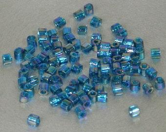 Toho 1.5mm Cube, Transparent Rainbow Blue Zircon (167BD), 10 grams