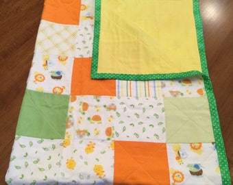 Baby Crib Quilt with chicks, turtles, lions, giraffes, birds and stripes in green, orange, yellow and white, CUDDLEUPQUILTSnMORE, toddler