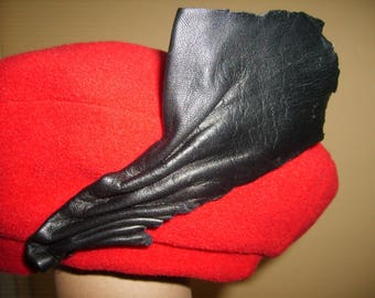 Red leather fleece beret draped black
