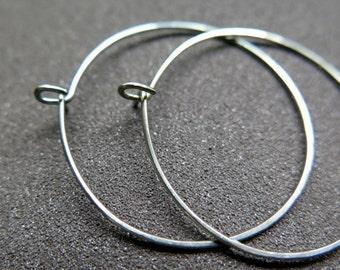 hypoallergenic hoop earrings. hammered niobium hoops. made in Calgary, Alberta.