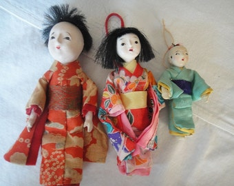 Vtg Japanese family of miniature dolls