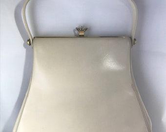 sac à main Dal'on des années 1940 en très bon état! Livré avec miroir et porte-monnaie original. FAIRE UNE OFFRE
