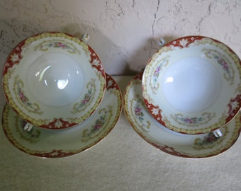 A Pair of Double Handled Cream Soup Cups and Saucers - Ransom China