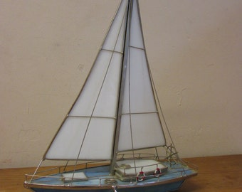 Delicate vintage metal and slag/stained glass sail boat art sculpture, blue & white with red flag